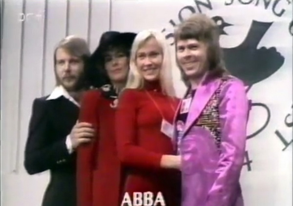 ABBA are introduced in a pre-performance segment at the 1974 Eurovision Song Contest. Viewers had no idea what outlandish costumes would greet them when ABBA took the stage.