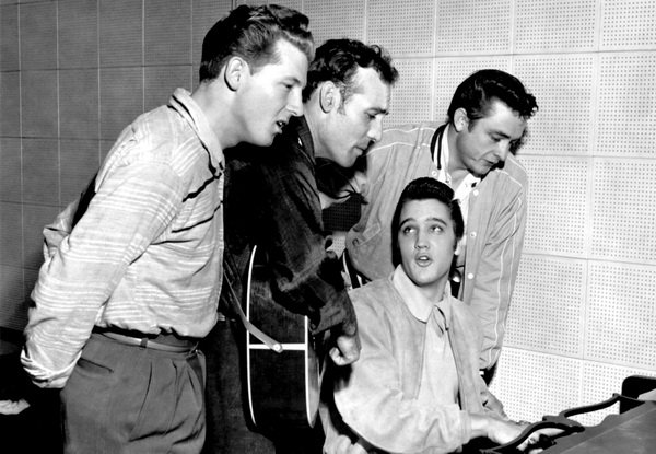 Million Dollar Quartet: Jerry Lee Lewis, Carl Perkins, Johnny Cash and Elvis Presley. Three of them play a role in the story of Blue Suede Shoes. Lewis later also covered it, and Cash played it on stage.